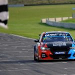 TURKINGTON SURVIVES EARLY SCARE TO SECURE RACE ONE WIN