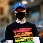 Mick Schumacher insists he is '95% happy' with F1 debut despite spinning off early at Bahrain Grand Prix... as son of seven-time world champion Michael admits he needs to learn to cope with being overtaken so much after winning F2 title last year
