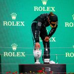 Lewis Hamilton struggles to stand up on podium as 'fatigued and dizzy' Brit fears long Covid after  Hungarian GP