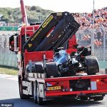 Williams driver Nicholas Latifi spins off the track and smashes into the barrier, causing a lengthy delay in qualifying at the Dutch Grand Prix... just minutes after his team-mate George Russell had his own accident!